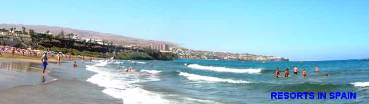 Playa del ingles beach panorama with San Agustin in the distance