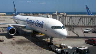 Thomas Cook plane Gran Canaria and the tail fin of an Excel airways plane <strong>at Gran Canaria airport</strong>